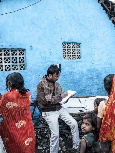 social field worker collecting information of beneficiary families